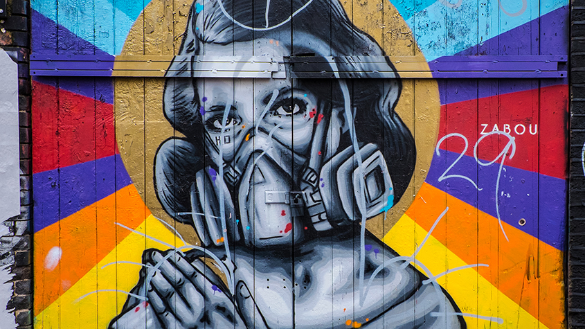 Brick Lane street art - graffiti woman with gas mask