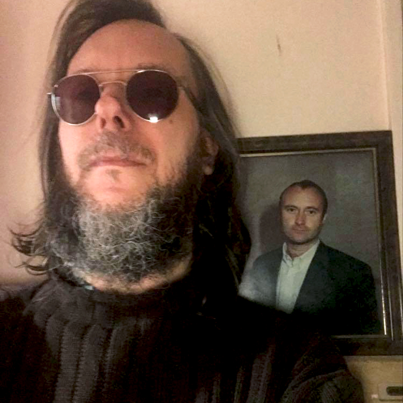 David with photo of Phil Collins