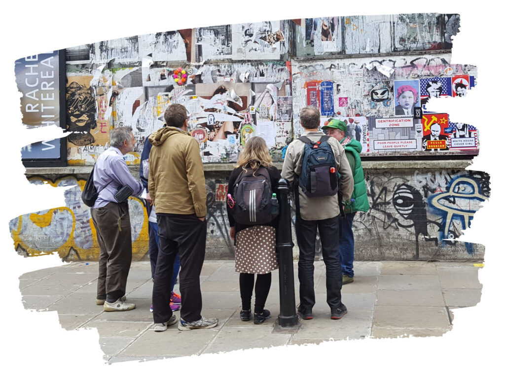 Unseen Tours Guide Pete shows visitors street art on Brick Lane